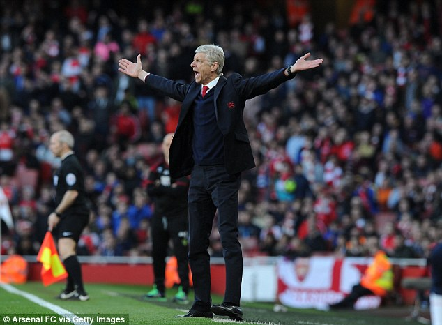 Wenger gesticulates on the touchline as his side beat Norwich to all but cement another top four finish