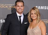 """LOS ANGELES, CA - NOVEMBER 16: Actor Wes Chatham and wife Jenn Brown arrive at the premiere of Lionsgate's """"The Hunger Games: Mockingjay - Part 2"""" at Microsoft Theater on November 16, 2015 in Los Angeles, California.  (Photo by Gregg DeGuire/WireImage)"""