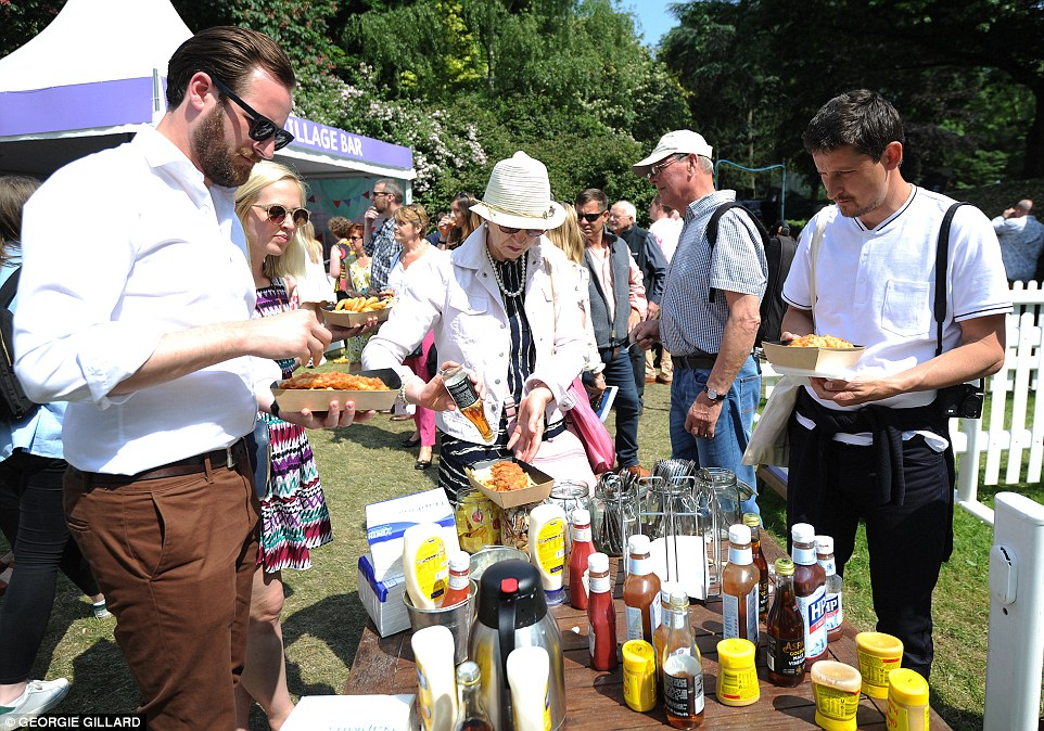 Visitors to the Chelsea Flower Show enjoying the food and drink on offer around the grounds as the temperature heats up