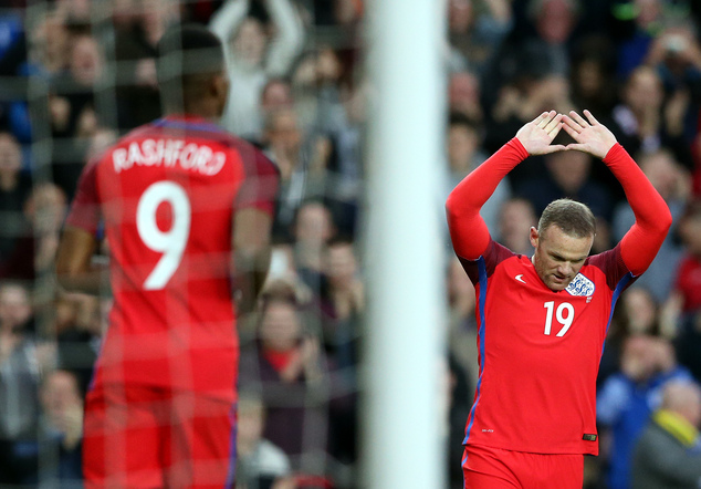 England's Wayne Rooney, right, celebrates his goal during the international friendly soccer match between England and Australia at the Stadium of Light, Sund...