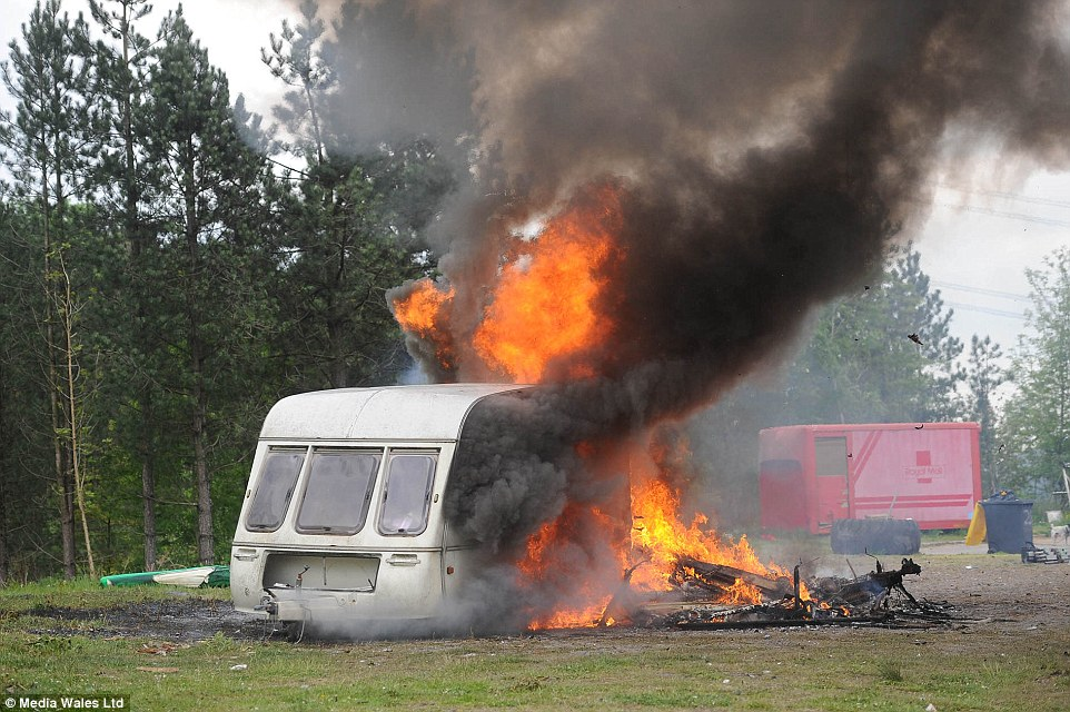 Travellers have burnt four caravans belonging to the 'Queen of the Gipsies' Ruby Pearl Marshall following her funeral on Thursday in Wales