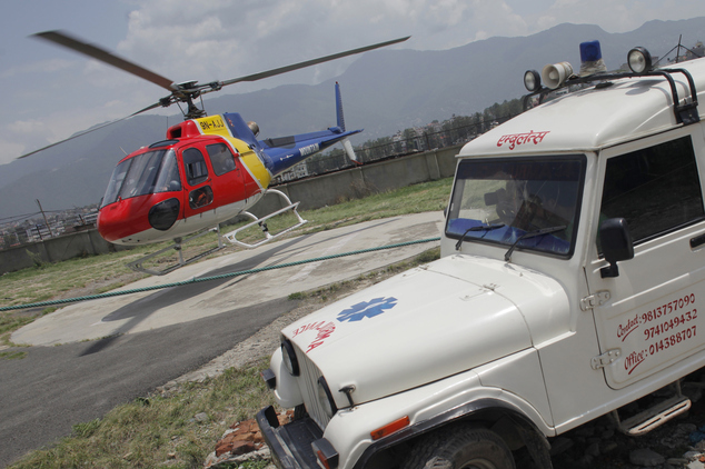 An helicopter carrying the body of Dutch climber Eric Arnold lands at Teaching hospital helipad in Kathmandu, Nepal, Thursday, May 26, 2016. Arnold died last...