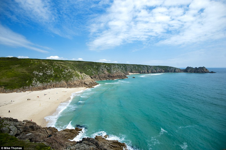 Glorious day: The stunning weather at Porthcurno beach in Cornwall this morning as people prepare for the Bank Holiday weekend