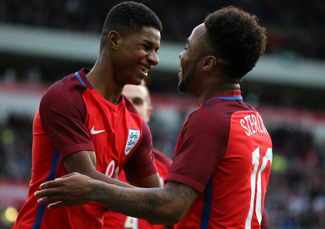 England's Marcus Rashford, left, celebrates his goal with Raheem Sterling, during the international friendly soccer match between England and Australia at th...