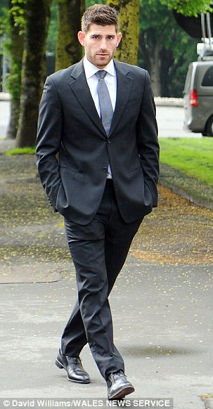 Back in the dock:Footballer Ched Evans has arrived at Cardiff Crown Court today where he is expected to discover the date for his new rape trial.