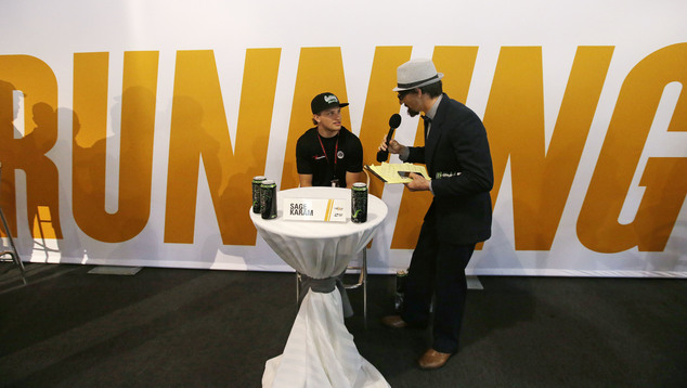 Sage Karam listens to a question from Josef Newgarden, who is dressed up as a reporter, during a news conference for the Indianapolis 500 auto race at Indian...