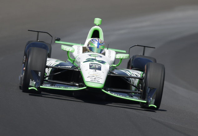 Sage Karam drives through turn one during the final practice session for the Indianapolis 500 auto race at Indianapolis Motor Speedway in Indianapolis, Frida...