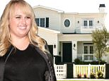 *EXCLUSIVE* West Hollywood, CA - General views of Rebel Wilson's new $3 Million Dollar House. The two-story Traditional, built last year by ROMM Remodeling, has classic curb appeal with a white picket fence, eggshell-colored siding and a decorative oval window above the front door. A covered porch sits off the entrance. Inside, the roughly 4,400-square-foot house features vaulted and coffered ceilings, wide-plank wood floors, delicate wainscoting and a range of white and gray hues. A glass-enclosed wine cellar sits below the stairs.\nAKM-GSI    June 3, 2016\nTo License These Photos, Please Contact :\nMaria Buda\n(917) 242-1505\nmbuda@akmgsi.com\nsales@akmgsi.com\nor \nMark Satter\n(317) 691-9592\nmsatter@akmgsi.com\nsales@akmgsi.com