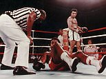Muhammad Ali (Cassius Clay) knocks George Foreman to the ground in the world title fight known as the 'Rumble in the Jungle' in Zaire.