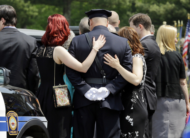 Mourners make their way into St. Joseph's Church during the funeral for Auburn Police Officer Ronald Tarentino Jr., Friday, May 27, 2016, in Charlton, Mass. ...