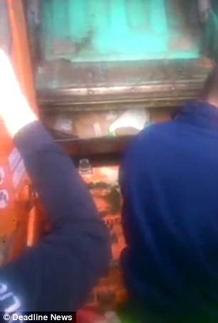 Help! Emergency services attempt to rescue a man, called Daniel, who is stuck inside a garbage truck