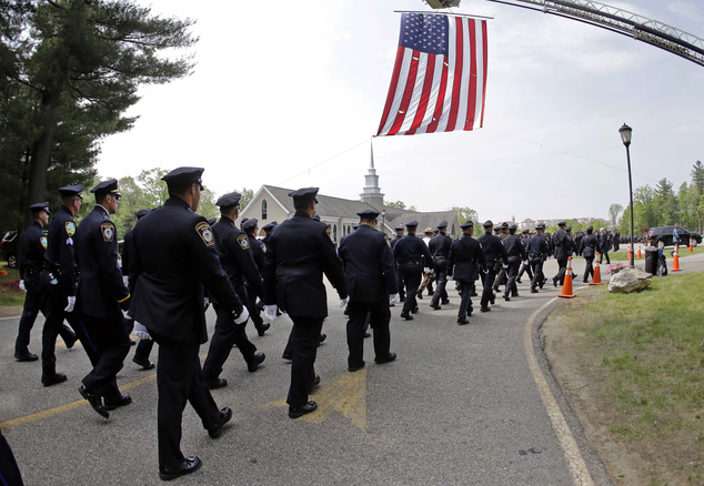 Police march to St. Joseph's Church during the funeral for Auburn Police Officer Ronald Tarentino Jr., Friday, May 27, 2016, in Charlton, Mass. Authorities s...