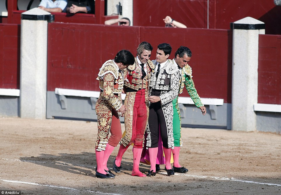Defeated: Juan Jose Padilla was helped to his feet by colleagues after the bull got its own back on the matador