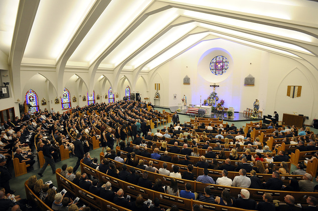 Mourners enter the funeral service for Auburn Police Officer Ronald Tarentino, of Leicester, Mass., in St. Joseph's Catholic Church in Charlton, Mass., on Fr...
