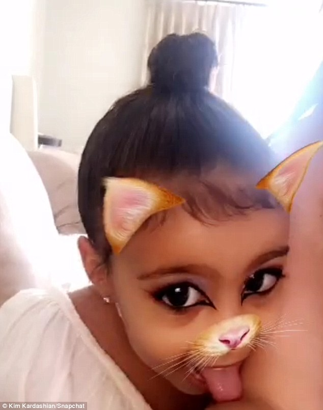 Meow: 'Look at my little pretty kitty,' the reality star said as Nori tried out the cat filter and gave her mom another lick on the arm