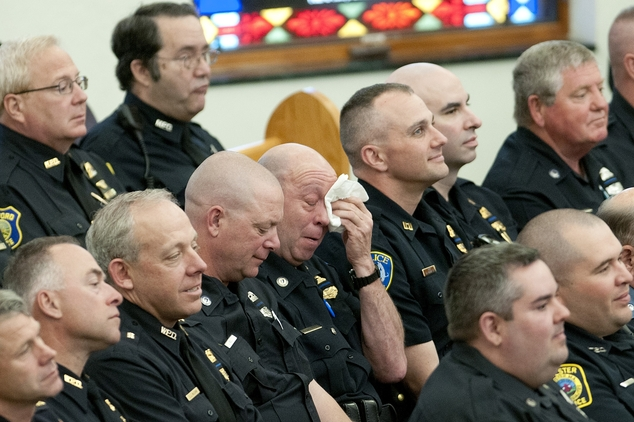 Police officers attend the funeral service for Auburn Police Officer Ronald Tarentino, of Leicester, Mass., at St. Joseph's Church in Charlton, Mass., Friday...