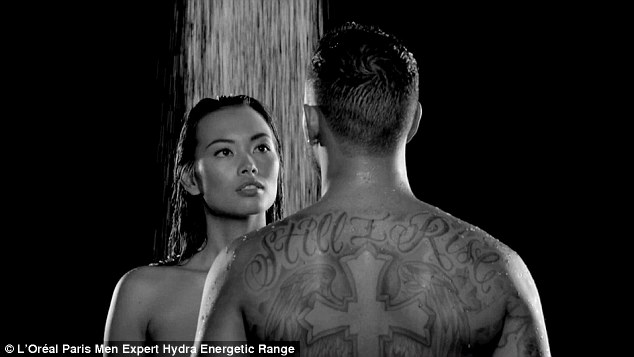 Two's company:Sizzling in the new black and white advert for the brand, the racing driver, 31, showed off his muscular torso as he stripped off to film himself lathering up in the shower with an attractive model