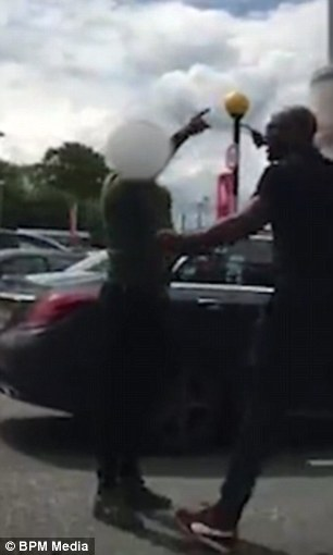 The driver can be seen gesturing wildly and shouting at Arena Shopping Park in Rowley's Green, Coventry