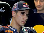 KTM Moto3 rider Luis Salom of Spain looks on before the first free practice session ahead the Valencia Motorcycle Grand Prix at the Ricardo Tormo racetrack in Cheste, near Valencia, November 8, 2013. REUTERS/Heino Kalis/File Photo