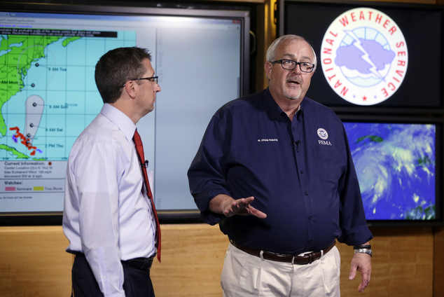 FILE- In this Oct.1, 2015 file photo, Craig Fugate, Administrator of the Federal Emergency Management Agency (FEMA), right, talks about the status of Hurrica...