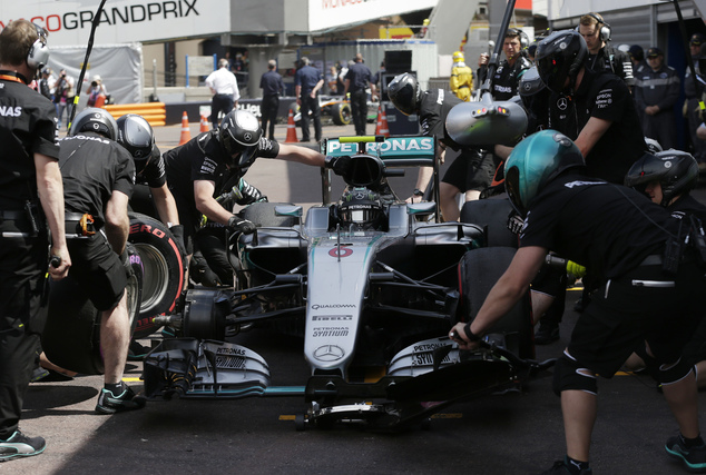 Mercedes driver Nico Rosberg of Germany has his tires changed during the second free practice at the Monaco racetrack in Monaco, Thursday, May 26, 2016. The ...