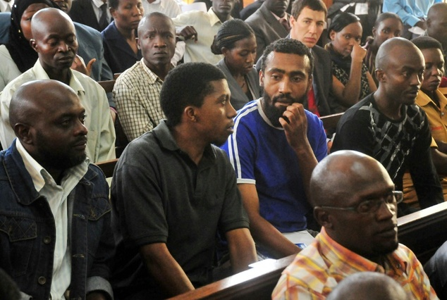 Issa Ahmed Luyima (R) appears in a court in Kampala in 2011 to face charges in connection with a twin-terrorist attack the previous year that killed at least...