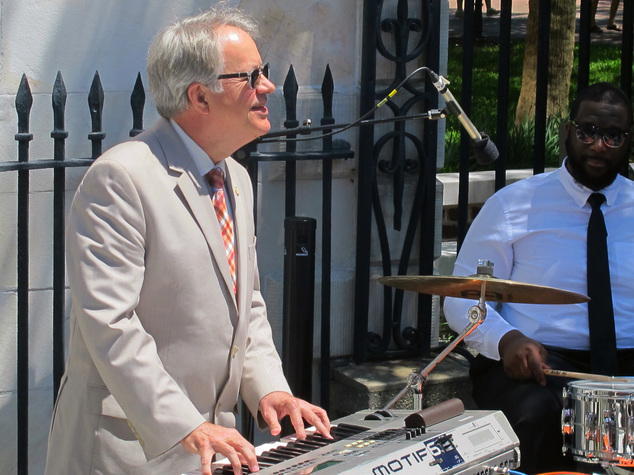 Charleston Mayor John Tecklenburg plays keyboards with a jazz combo just before the opening ceremonies of the 40th Spoleto Festival USA in front of city hall...