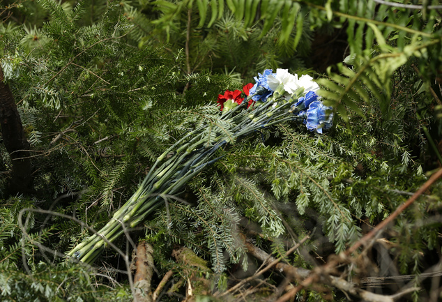 In this Wednesday, May 25, 2016 photo, a bouquet of red, white, and blue flowers that was left by detectives with the Snohomish County Sheriff's Office marks...