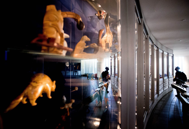 FILE - In this Tuesday, May 24, 2016 file photo, a man looks at Native American artifacts as a group of American Indian advocates hold a news conference near...
