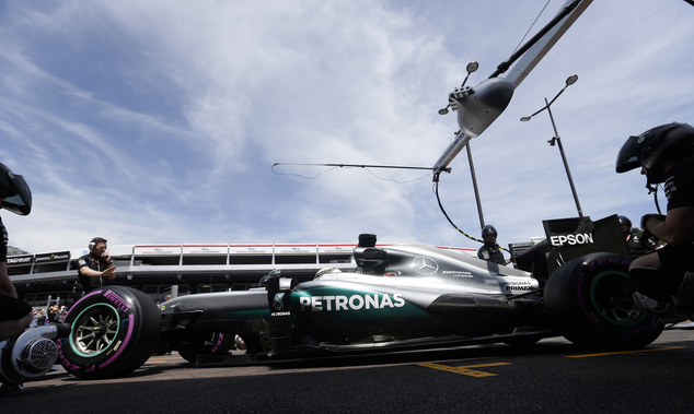 Mercedes driver Lewis Hamilton of Britain parks his car in front of the team garage during the second free practice at the Monaco racetrack in Monaco, Monaco...