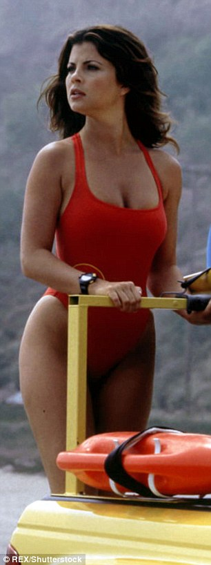 Spot the difference: Chloe bore a striking resemblance to Yasmine Bleeth's famed Baywatch character, Caroline Holden, as she emerged from the shore in her scanty red swimsuit