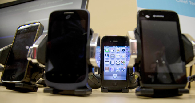 FILE - This Wednesday, Feb. 19, 2014 file photo shows a display of cell phones during a Federal Trade Commission (FTC) mobile tracking demo in Washington. On...