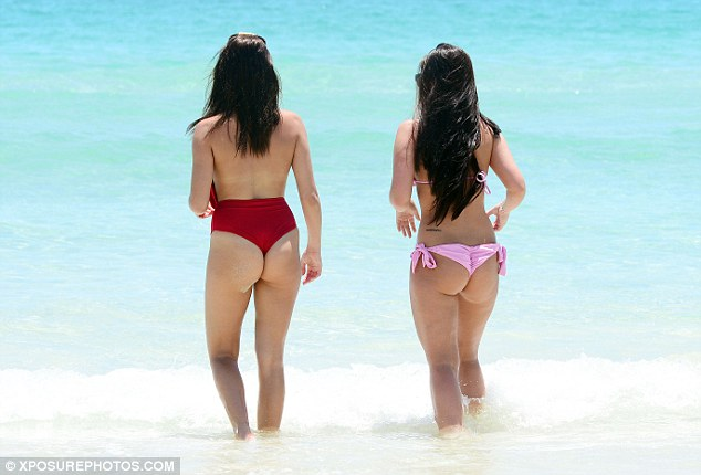 Beach bums: The pair seemed to be enjoying having a relaxing day out on the shores of Miami