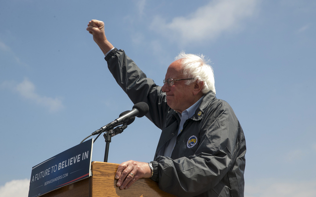 Democratic presidential candidate Sen. Bernie Sanders, I-Vt. salutes at a campaign rally at the Los Angeles Maritime Museum in San Pedro district of Los Ange...