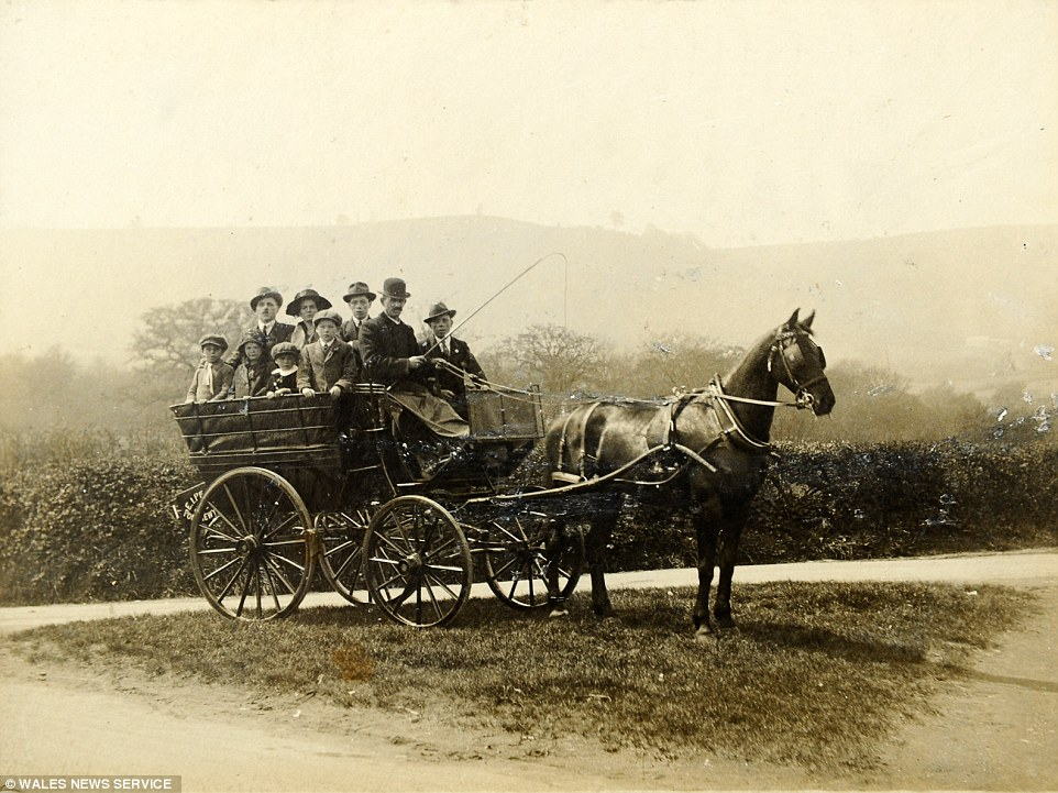 Grand designs: Edmund Peake takes a group through the South Wales countryside on his horse-drawn carriage in around 1900