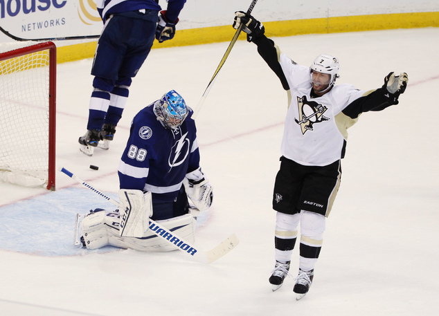 Pittsburgh Penguins center Matt Cullen (7) celebrates a goal by teammate Sidney Crosby (87), as Tampa Bay Lightning goalie Andrei Vasilevskiy (88), of Russia...