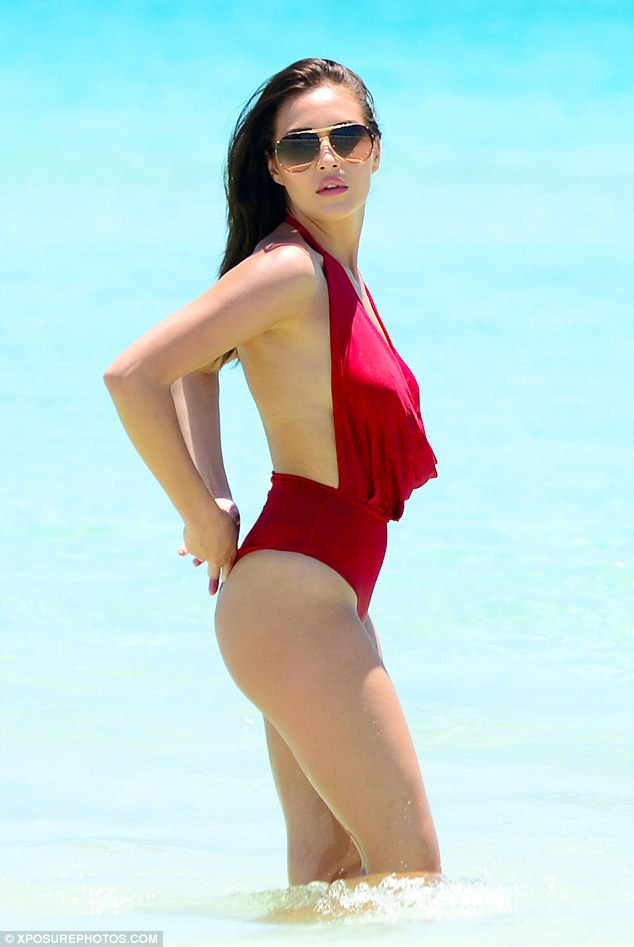Babewatch:Chloe Goodman was showing off every inch of her enviable figure as she slipped into a skimpy red swimsuit to frolic on the shores of Miami Beach on Thursday