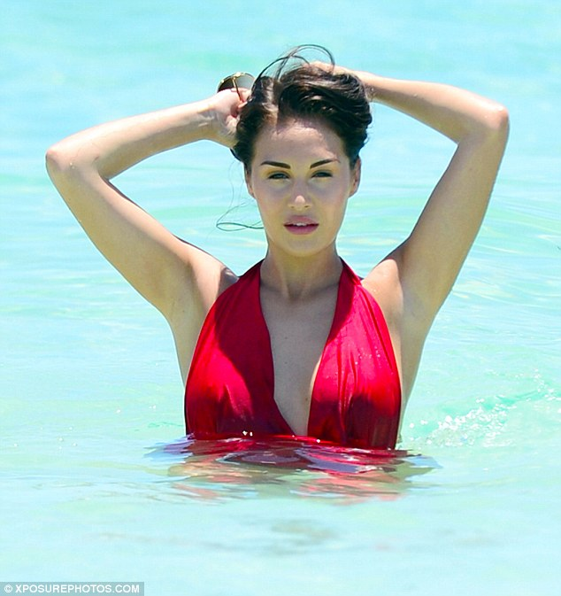 A sight to sea: The brunette beauty kept her head firmly above water, ensuring her slick of rosy lipgloss and contoured complexion would not waver