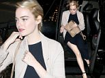 New York, NY - Emma Stone steps out in Midtown wearing a black dress and a beige duster coat paired with single strap heels. \nAKM-GSI       June 3, 2016\nTo License These Photos, Please Contact :\nMaria Buda\n(917) 242-1505\nmbuda@akmgsi.com\nsales@akmgsi.com\nMark Satter\n(317) 691-9592\nmsatter@akmgsi.com\nsales@akmgsi.com