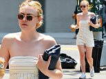 Exclusive... 52080392 Actress Dakota Fanning is spotted out and about in New York City, New York on June 3, 2016. Dakota was showing some skin during the sunny summer outing. FameFlynet, Inc - Beverly Hills, CA, USA - +1 (310) 505-9876