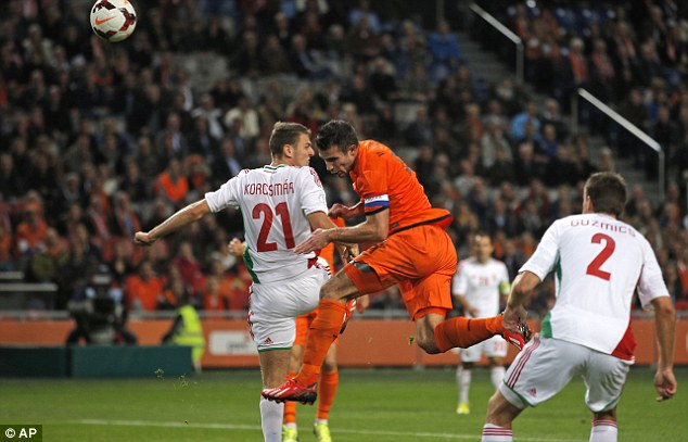 Aerial threat: Van Persie even scored with a header as Holland swept Hungary aside