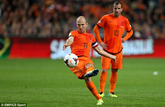 Curling in: Arjen Robben added Holland's eighth with a last-gasp free-kick