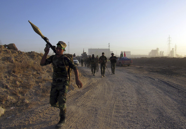 FILE - Iraqi security forces and allied Shiite Popular Mobilization Forces and Sunni tribal fighters, take combat positions outside in Fallujah, 40 miles (65...