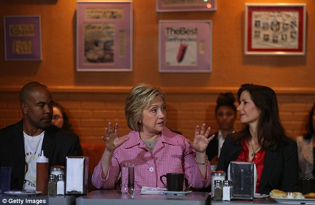 Derreck Johnson (left), the owner of the Home Of Chicken And Waffles, told Clinton that 70 per cent of his staff had served time behind bars