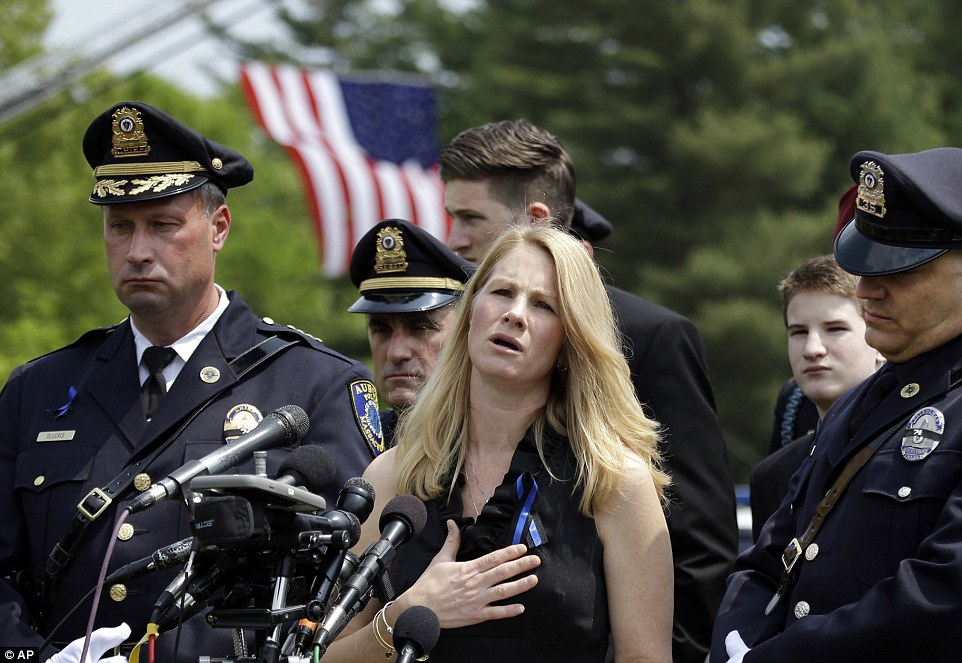 Ronald Tarentino, 42, was laid to rest in Charlton five days after getting shot in the back during a traffic stop in Auburn, Massachusetts. His wife Tricia (pictured) gave him a touching tribute beforehand