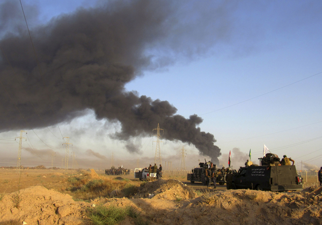 FILE - Smoke rises from Islamic State group positions after an airstrike by U.S.-led coalition warplanes in Fallujah, as Iraqi security forces and allied Shi...