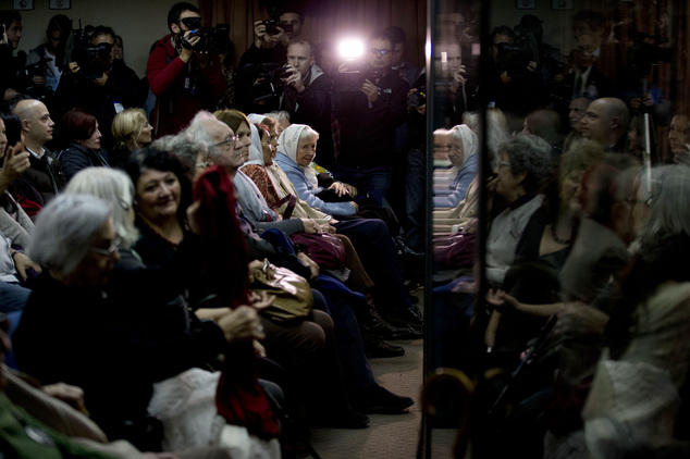 People sit in federal court to hear the sentence for former military officers in Buenos Aires, Argentina, Friday, May 27, 2016. The court will deliver a sent...