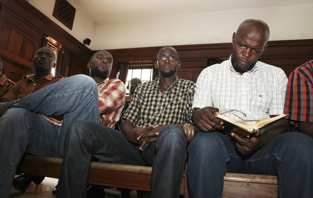 Sulaiman Nyamadondo, left, Hussein Hassan, center, and Muhammed Hamid, right, are sentenced for their role in the 2010 bombings that killed 76 people who wer...