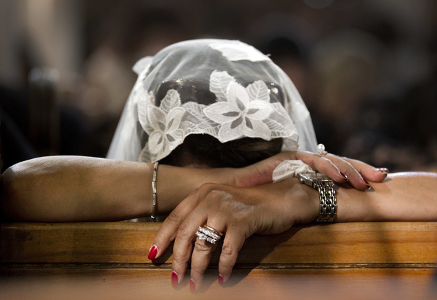 FILE - In this Sunday, May 22, 2016 file photo, A Coptic Christian grieves during prayers for the departed, remembering the victims of Thursday's crash of Eg...