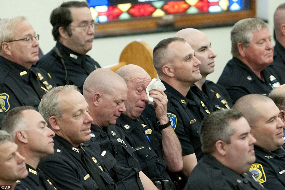 Auburn Police Chief Andrew Sluckis remembered Tarentino as a humble man with a 'larger than life personality'. Pictured, police officers attend the funeral service on Friday